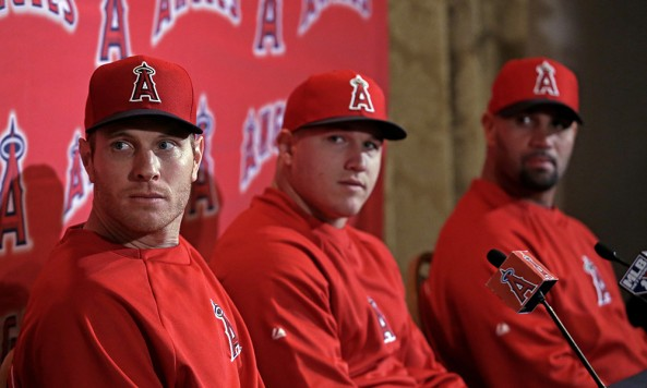 ngels-players-from-left-Josh-Hamilton-Mike-Trout-and-Albert-Pujols-attend-a-news-conference-at-spring-training-baseball-Thursday-Feb_-14-2013-in-Tempe-Ariz_[1]